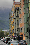 Innsbruck, pastel painted property against the back ground of the forests and mountains. Innsbruck,Tyrol, Austria.