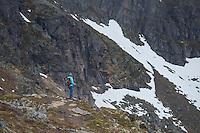 Female hiker in mountain landscape near summit of Festvågtind, Austvågøy, Lofoten Islands, Norway