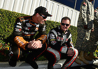Nov. 11, 2012; Pomona, CA, USA: NHRA top fuel dragster driver Clay Millican (left) talks with Steve Torrence during the Auto Club Finals at at Auto Club Raceway at Pomona. Mandatory Credit: Mark J. Rebilas-