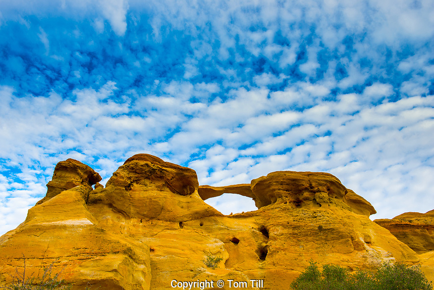 Natural arch and morning clouds, BLM lands, New Mexico