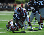 Ole Miss running back Brandon Bolden (34) is tackled by Jacksonville State defensive end Jamison Wadley (93) and Jacksonville State linebacker Morrell Jones (43) at Vaught-Hemingway Stadium in Oxford, Miss. on Saturday, September 4, 2010.
