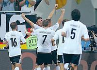 Mario GOMEZ, DFB 23 jubelt nach dem Tor zum 1-0 mit Bastian SCHWEINSTEIGER, Nr.7 DFB ..DEUTSCHLAND - PORTUGAL ( : )..Gruppenspiel, Gruppe B , Deutsche Fussball Nationalmannschaft, DFB EM Euro 2012 am  09.06.2012 in Lviv, Lemberg, U K R A I N E Europameisterschaft 2012 in P o l e n, U k r a i n e..Fotograf: Peter Schatz..www.peterschatz.com..0171-8300650..ps@magics.de.. *** Local Caption ***  Foto ist honorarpflichtig nach MFM.. St.nr: 112/266/60560,  Honorar zuzuegl. Mwst. 7%..M ue n c h n e r B a n k BLZ 70190000 , Nr.7651562..BIC: GENODEF1M01  ..IBAN: DE78 7019 000 0000 7651562....Es gelten ausschliesslich die AGB von Peter Schatz..Auszug:..III. Nutzungsrechte..1. Der Kunde erwirbt grundsaetzlich nur ein einfaches Nutzungsrecht zur einmaligen Verwendung...6. Der Kunde ist nicht berechtigt, die ihm eingeraeumten Nutzungsrechte ganz oder teilweise auf Dritte, auch nicht auf andere Konzern- oder Tochterunternehmen, zu uebertragen...