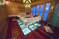 Maldives, Rangali Island. Conrad Hilton Resort. Inside of the spa and massage tables overlooking the water.