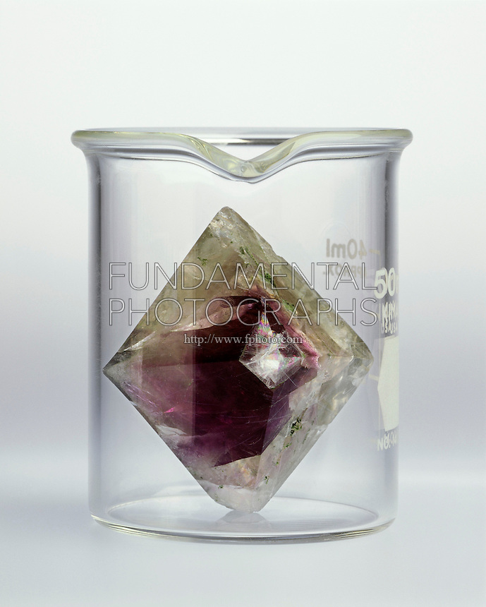 CRYSTAL DOES NOT TAKE OF CONTAINER SHAPE<br /> A Solid Retains Its Shape<br /> A solid (fluorite crystal) will not fill a container conforming to the shape of the container unless it is finely divided.