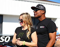 Mar 19, 2017; Gainesville , FL, USA; NHRA top fuel driver Antron Brown (right) talks with Brittany Force during the Gatornationals at Gainesville Raceway. Mandatory Credit: Mark J. Rebilas-USA TODAY Sports