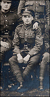 BNPS.co.uk (01202 558833)<br /> Pic: PhilYeomans/BNPS<br /> <br /> A much more world weary and decorated Ln Cpl William Taylor at the end of the war.<br /> <br /> Saved by pictures of his loving family...<br /> <br /> An amazing tale of a heroes lucky survival through the entire First World War has been uncovered after his family revealed his remarkable tale to a local history group.<br /> <br /> Photos of loved ones that saved a soldier's life by stopping a piece of shrapnel aimed for his heart have come to light - complete with the holes the fragment left behind.<br /> <br /> Private William Taylor kept the nine pictures of his family in his wallet in his breast pocket during the entire four years of World War One.<br /> <br /> In a remarkable quirk of fate he survived a battle which left three quarters of his regiment dead or injured thanks to the stack of photos which took the impact of a shell blast.<br /> <br /> The projectile pierced the outer layer of his leather wallet and perforated eight of the nine photos.<br /> <br /> Luckily, the last picture of his younger sister Lilly stopped the fragment from going any further.