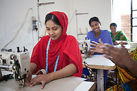 Mili Khatun (left) survived the collapse of Rana Plaza on April 24, 2013 but her husband didn't. Mili and another four survivors now work in a model garment factory called 'Oporajeo', a worker-owned factory in Savar, near Dhaka, Bangladesh