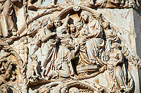 Bas-relief sculpture panel scene of the Tree Kings bringing gifts to the baby Christ by Maitani around 1310 on the14th century Tuscan Gothic style facade of the Cathedral of Orvieto, Umbria, Italy