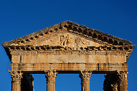 Detail of the pediment and entablature of the Roman Capitol, 2nd century, in Dougga, Tunisia, pictured on January 31, 2008, in the morning. Dougga has been occupied since the 2nd Millennium BC, well before the Phoenicians arrived in Tunisia. It was ruled by Carthage from the 4th century BC, then by Numidians, who called it Thugga and finally taken over by the Romans in the 2nd century. Situated in the north of Tunisia, the site became a UNESCO World Heritage Site in 1997. This is one of the best preserved Roman temples in North Africa with a portico of six Corinthian columns. Picture by Manuel Cohen.