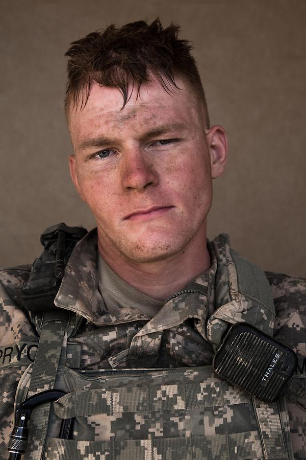PFC Nathaniel Pryor. Deposit, New York. 24. Charlie Co. 1st Battalion 12th Infantry Regiment, 4th Infantry Division. Photographed at Combat Outpost JFM in Zhari District, Kandahar, Afghanistan.