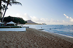 The Halekulani Hotel, the Hawaiian name meaning House Befitting Heaven, located on Waikiki beach in Honolulu, Hawaii offers stunning views of Diamond Head in a historic, secluded and exclusive setting. The beach in front of the Halekulani.