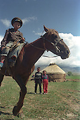A family, with their horse, by their yurt which they live in during the summer months, on the land which they work, near Lake Issyk-Kul, in the Alatau range of the Tian Shan mountains. Near Lake Issyk-Kul, Kyrgyzstan.