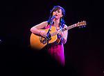 Woman playing guitar. Katherine Hepburn Center.