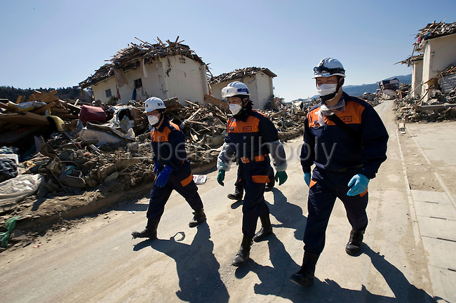 National police officers begin a search for those missing after the March 11 magnitude 9 quake and subsequent tsunami in Rikuzentakata on April 6, 2011..Photographer: Robert Gilhooly