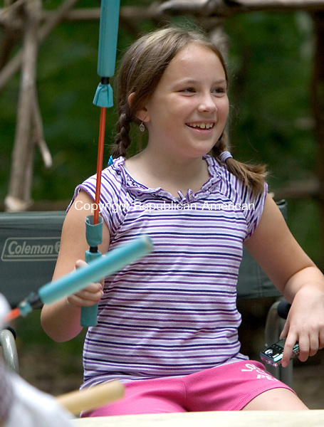 (Countrylife Use Only)<br /> WASHINGTON, CT. 06 August 2011-080611SV10--Kaylyn Madahbee, 9, of Oxford tries drumming during the annual corn festival held at the Institute for American Indian Studies in Washington Saturday.<br /> Steven Valenti Republican-American