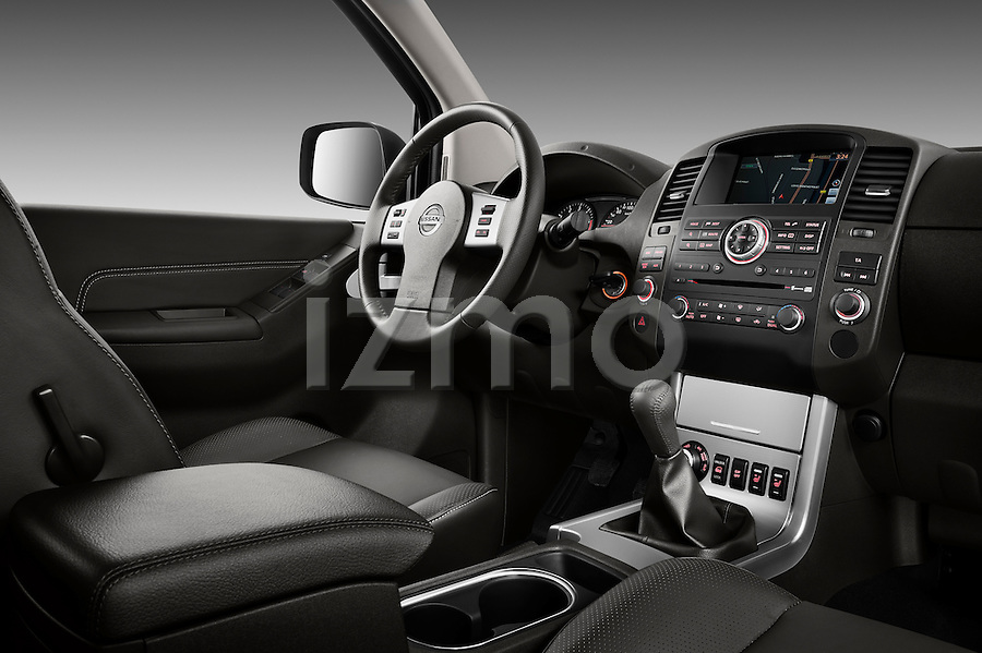 side dashboard view of a 2010 Nissan Navara LE 4 door Pick-Up Truck