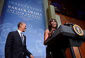 First Lady Michelle Obama, with United States President Barack Obama, steps up to the podium to deliver remarks at the Inaugural Reception at the National Building Museum in Washington, DC, USA, 20 January 2013. Obama defeated Republican candidate Mitt Romney on Election Day 06 November 2012 to be re-elected for a second term..Credit: Shawn Thew / Pool via CNP
