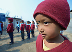 Children line up to begin the day at the Shri Pashupati Praja Primary School in the village of Tanglichowk, in the Gorkha District of Nepal. In the aftermath of the April 2015 earthquake that ravaged Nepal, the ACT Alliance helped people in this village with a variety of services, including latrines, emergency shelter, livelihood projects and school construction.