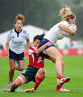 Johana Grisez of France is tackled by Rafaela Xavier of Portugal. FISU World University Championship Rugby Sevens Women's Semi Final between France and Portugal on July 9, 2016 at the Swansea University International Sports Village in Swansea, Wales. Photo by: Patrick Khachfe / Onside Images