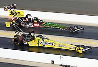 Sep 15, 2013; Charlotte, NC, USA; NHRA top fuel dragster driver Morgan Lucas (near) races alongside Terry McMillen during the Carolina Nationals at zMax Dragway. Mandatory Credit: Mark J. Rebilas-