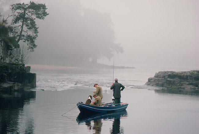 Fishing from a boat on a misty morning. Campsie Lin. River Tay. Scotland.