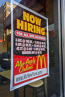 A sign in the window of a McDonald's restaurant in New York on Thursday, January 3, 2013 directs prospective employees to franchise locations where they can apply for work. (© Richard B. Levine)