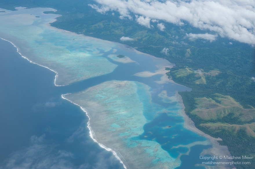 Vanua Levu, Fiji; aerial view of coral reefs just offshore while flying from Viti Levu to Taveuni