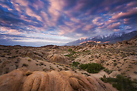"""ANCIENT HILLS"" - Sunrise light over the Alabama Hills in central California. The eastern Sierra and Mount Whitney are snow-capped in the distance."