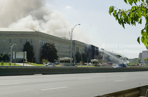 Washington, DC - September 11, 2001 -- Firetrucks pour water onto the damaged part of the Pentagon following the terrorist attack in Washington, D.C. on Tuesday, September 11, 2001..Credit: Ron Sachs / CNP