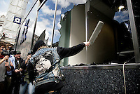 A demonstrator throws a missile at police inside the damaged Royal Bank of Scotland (RBS) building aas thousands of protestors descended on the City of London ahead of the G20 summit of world leaders to express anger at the economic crisis, which many blame on the excesses of capitalism. RBS was the focus of anger because it had to be bailed out by the government.