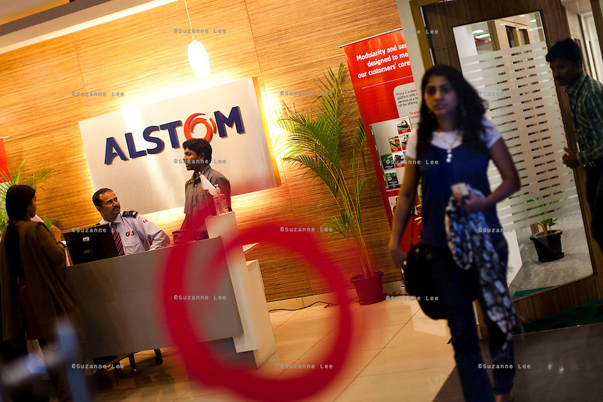 ALSTOM's employees and visitors are seen, through a glass, in the reception area of the office in Bangalore, Karnataka, India on 10th March 2011. .Photo by Suzanne Lee/Abaca Press