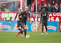 Toronto, Ontario - May 3, 2014: Toronto FC midfielder Michael Bradley #4 in action during a game between the New England Revolution and Toronto FC at BMO Field.<br /> The New England Revolution won 2-1.