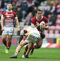 Wigan Warriors' Ben Flower is tackled by Huddersfield Giants' Sam Rapira <br /> <br /> Photographer Stephen White/CameraSport<br /> <br /> Betfred Super League Round 5 - Wigan Warriors v Huddersfield Giants - Sunday 19th March 2017 - DW Stadium - Wigan<br /> <br /> World Copyright &copy; 2017 CameraSport. All rights reserved. 43 Linden Ave. Countesthorpe. Leicester. England. LE8 5PG - Tel: +44 (0) 116 277 4147 - admin@camerasport.com - www.camerasport.com