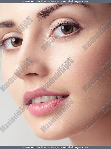 Young caucasian woman face with clean natural look and smooth skin closeup beauty portrait