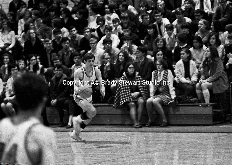 Bethel Park PA:  Mike Stewart 10 dribbling up the court during a basketball game against the Mt Lebanon Blue Devils at Bethel Park Gymnasium - 1968. Bruce Evanovich is in the foreground. The JV Team was coached by Mr. Reno and the Bethel Park JVs won the Section Championship.  The team included; Scott Streiner, Steve Zemba, John Klein, Mike Stewart, Bruce Evanovich, Jeff Blosel and Tim Sullivan.