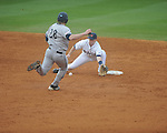 Ole Miss shortstop Austin Anderson (8) tags out Rhode Island's Kevin Stenhouse (28) at Oxford-University Stadium in Oxford, Miss. on Friday, February 22, 2013. Ole Miss won 8-1 to improve to 5-0.
