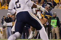 WVU tight end Tyler Urban makes a catch. The WVU Mountaineers beat the Pitt Panthers 21-20 at Mountaineer Field in Morgantown, West Virginia on November 25, 2011.