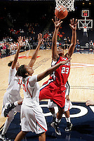 CHARLOTTESVILLE, VA- December 7: Avery Warley #23 of the Liberty Lady Flames shoots next to Telia McCall #30 and Ataira Franklin #23 of the Virginia Cavaliers during the game on December 7, 2011 at the John Paul Jones arena in Charlottesville, Va. Virginia defeated Liberty 64-38. (Photo by Andrew Shurtleff/Getty Images) *** Local Caption *** Ataira Franklin;Telia McCall;Avery Warley