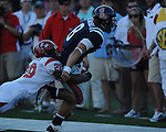 Ole Miss quarterback Jeremiah Masoli (8) is chased by Jacksonville State defensive back Keginald Harris (28)  at Vaught-Hemingway Stadium in Oxford, Miss. on Saturday, September 4, 2010. Jacksonville State won 49-48 in double overtime.