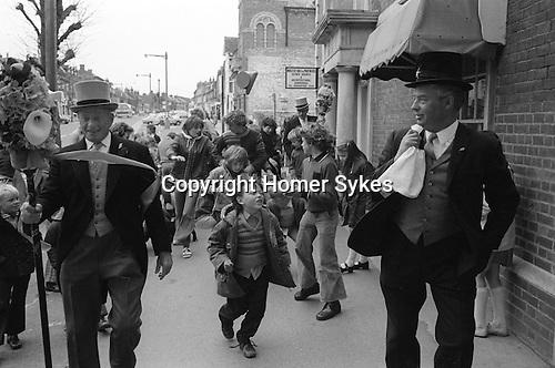 Hungerford Hocktide, Hungerford, Berkshire England 1976. The Tuttimen,Orange Man with sack over shoulder. Second Tuesday after Easter.<br /> <br /> Bob Lewington Orange Man, with sack over his shoulder.