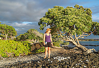 A woman pauses to look back from the King's Highway, a coastal path in Waikoloa, Hawai'i Island.