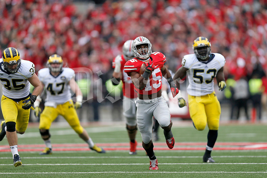 Ohio State Buckeyes running back Ezekiel Elliott (15) looks at the scoreboard during a 44 yard touchdown in the fourth quarter of the NCAA football game against Michigan at Ohio Stadium on Saturday, November 29, 2014. (Columbus Dispatch photo by Jonathan Quilter)