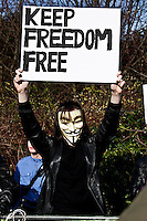 Protester - 2011<br /> <br /> London, 24/02/2011. At Belmarsh Magistrates Court (south London), Julian Assange faced his trial to be extradited to Sweden where the Wikileaks founder has to respond to three allegations of sexual assault and one of rape. District Judge Howard Riddle said the extradition would not breach Mr Assange's human rights. Assange was accompanied by his lawyer Mark Stephens and Jemima Khan (British writer and campaigner, Associate Editor of the New Statesman and European editor-at-large for Vanity Fair). In the meanwhile, outside the court people gathered in support and solidarity with Julian Assange.