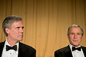 Washington, D.C. - April 21, 2007 - United States President George W Bush (R) and his spokesperson Tony Snow (L), who has been out since cancer was discovered listens to speakers during a surgery, at the White House Correspondents Association Dinner April 21, 2007 in Washington, DC.  Comedian Rich Little hosted and provided entertainment for President George W Bush, White House reporters, their guests and celebrities. .Credit: Brendan Smialowski - Pool via CNP