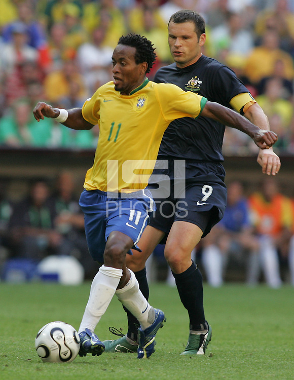 Ze Roberto (11) of Brazil is marked by Mark Viduka (9) of Australia. Brazil defeated Australia, 2-0, in their FIFA World Cup Group F match at the FIFA World Cup Stadium, Munich, Germany, June 18, 2006.