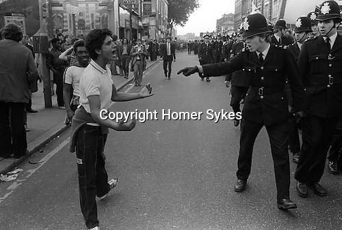 National Front march Lewisham, South London England 1977. Police confront a black youth. The police are protecting the NF from left wings demonstration against their march.<br />