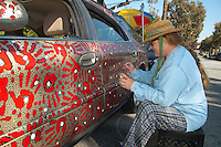 "Alison Hennessey hand paints her Ford Taurus entitled, ""Space Potto"" at Hill St. on Saturday, January 29, 2011."
