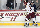 Brendan Silk (BC - 9), John Henrion (UNH - 16) - The Boston College Eagles and University of New Hampshire Wildcats tied 4-4 on Sunday, February 17, 2013, at Kelley Rink in Conte Forum in Chestnut Hill, Massachusetts.