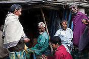 Local villagers from the Chowduli community gather outside a tea shop in Chaymalpur village of North 24 Parganas in West Bengal, India. Photo: Sanjit Das/Panos for The Wall Street Journal. Slug: ICASTE