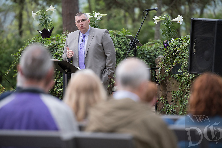NWA Democrat-Gazette/J.T. WAMPLER Rev. Carl Palmer offers a pastoral prayer Sunday April 16, 2017 at the 94th Annual Easter Sunrise Service at Mount Sequoyah in Fayetteville. Several hundred people attended the annual service at the Mount Sequoyah Retreat and Conference Center. Palmer is a reverend at Central United Methodist Church in Fayetteville.